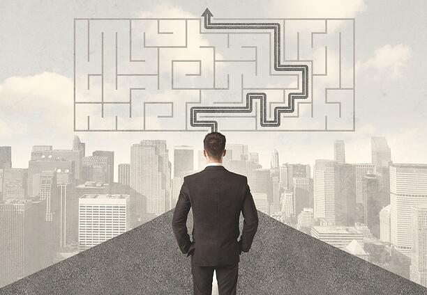 Businessman looking at road with maze and solution concept.jpeg
