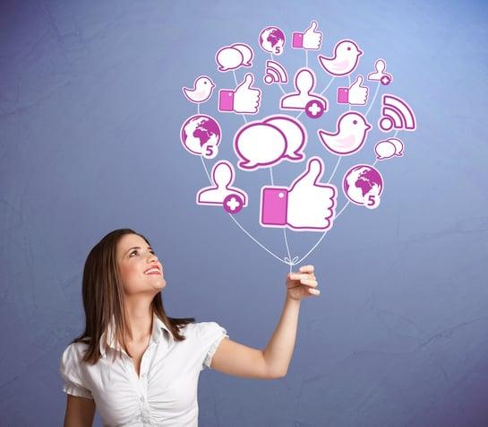 Young pretty woman holding social icon balloon.jpeg