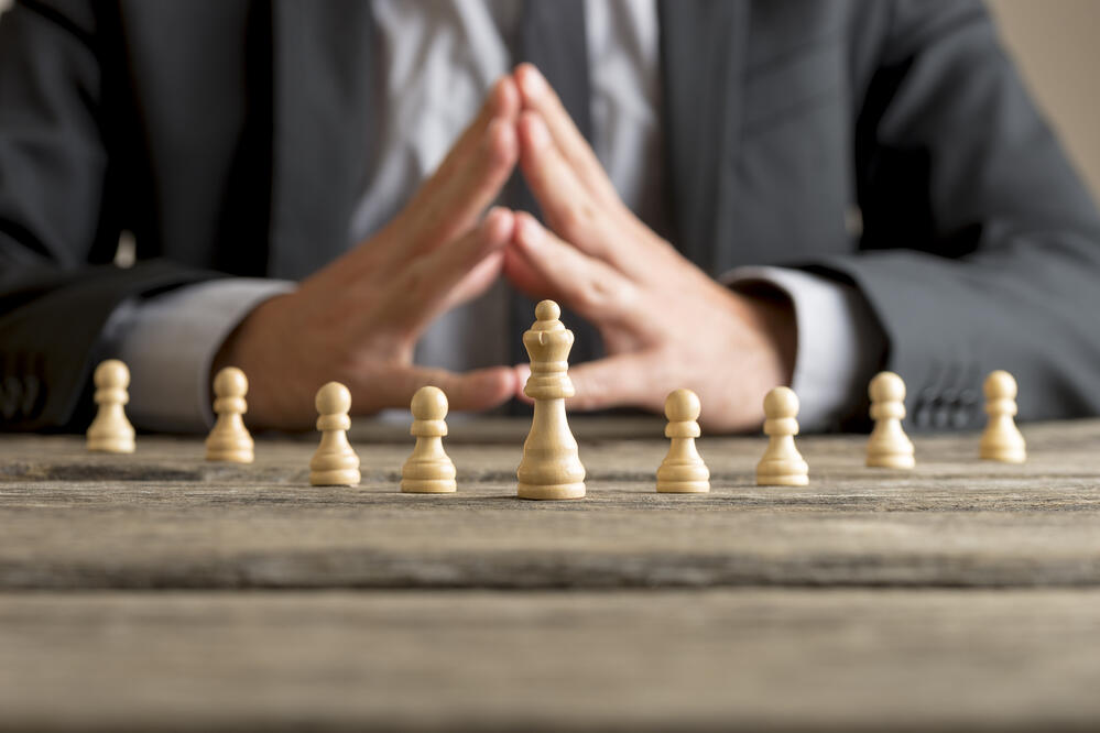 businessman-with-clasped-hands-planning-strategy-FVV93U4