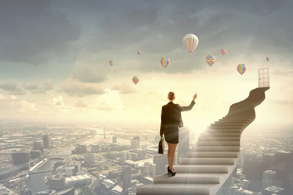 Businesswoman walking up staircase to door in sky-1