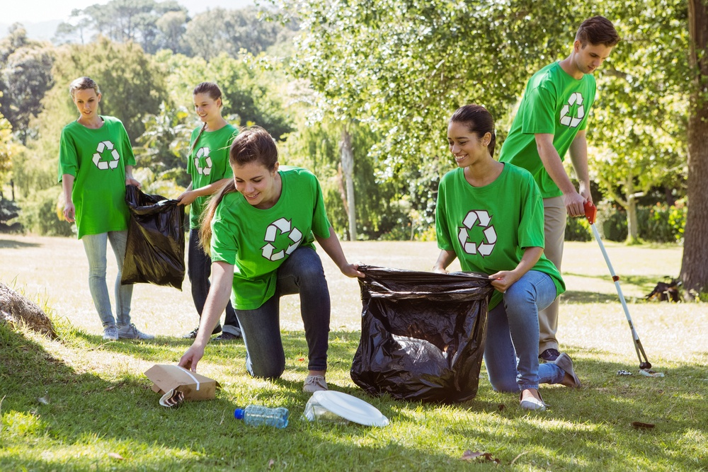 Environmental activists picking up trash on a sunny day.jpeg