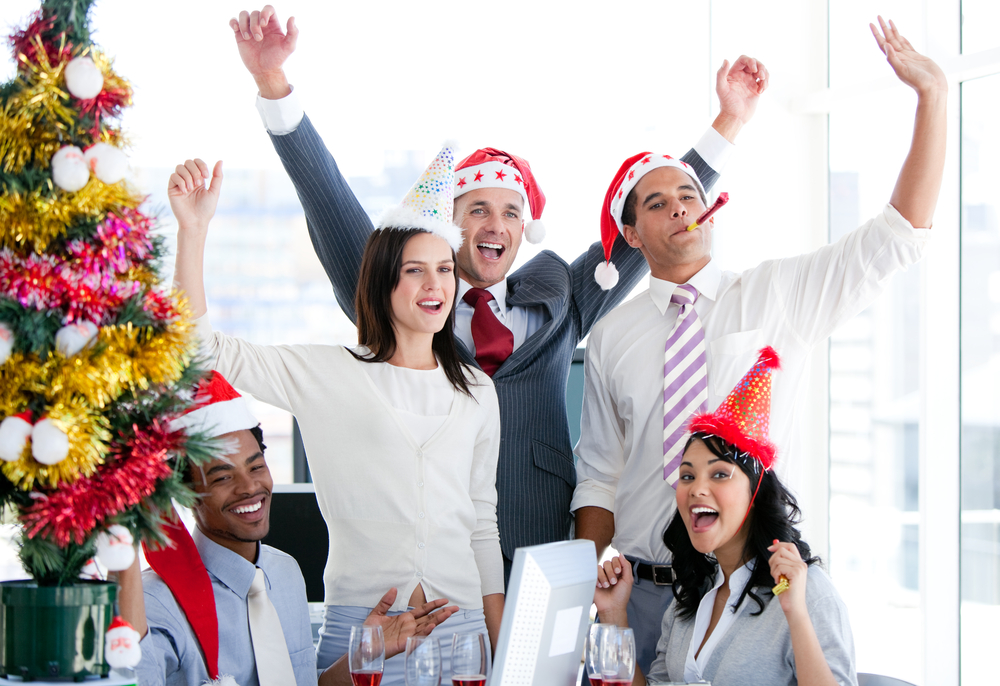 Nice business team punching the air to celebrate christmas in the office