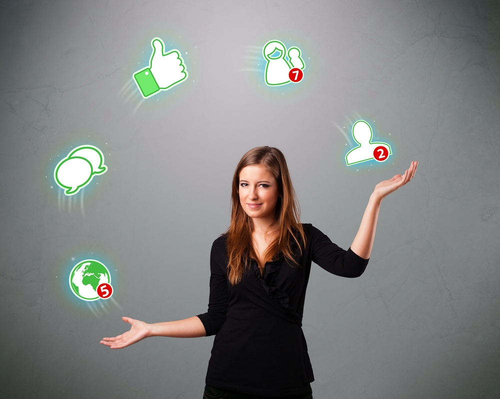attractive young woman standing and juggling with social network icons.jpeg